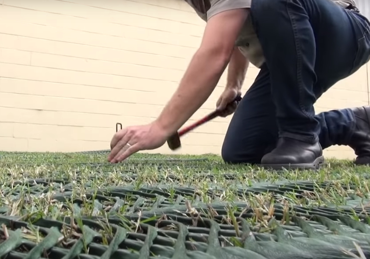 tack the grass reinforcement mesh to the soil